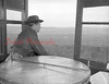 (March 1957) Boyers Knob in Coal Township. Frank Graboski, forestry inspector of the Shamokin District, surveys the area from atop of Boyers Knob tower.