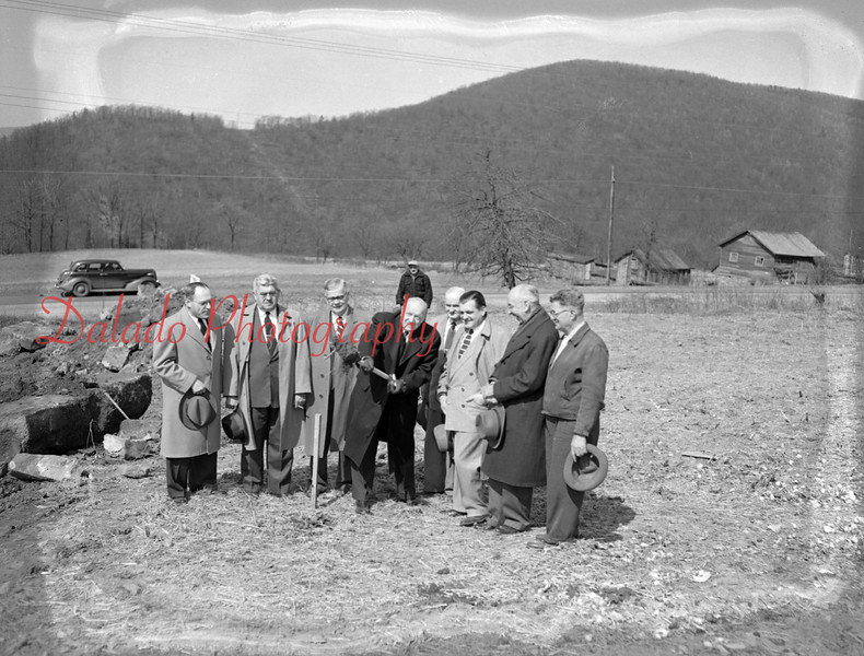 (04.04.55) Dr. George A. Deitrick, center, president of the Northumberland County Board of Commissioners, turns the first spade of earth for the new Juvenile Home, which commissioners will erect just east of the hospital on Trevorton Road. Attending the ceremony on April 4, 1955, were, from left, Rev. Truman Baker, superintendent of the county home at Sunbury, Sydney Freeman, institutional district director; John U. Shroyer, secretary of the board of commissioners; Leo J. Bradler, institutional district investigator; George F. Perles, Democratic commissioner; Edwin F. Smith, architect; and John Latshaw, superintendent of construction.