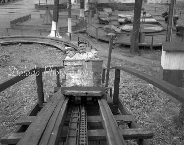 May 1952- Awaiting the big dip are Mr. Faust, a maintenance man at Edgewood Park, and two of his new friends who wanted to go for a free ride. The two boys are Harry Bramhall, left, and Edward Armstrong.