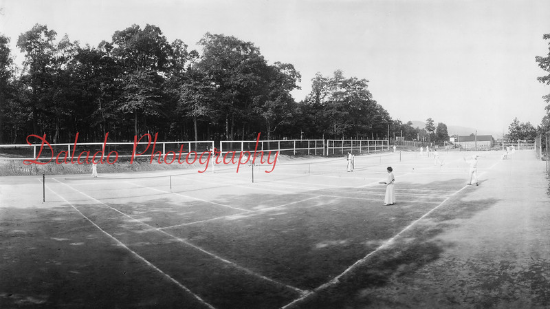 (1915) Tennis courts at Edgewood Park. When is the last time you saw women playing tennis in full-length dresses?