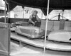 Dennis Shuey fixes a kiddie ride (May 19, 1953)