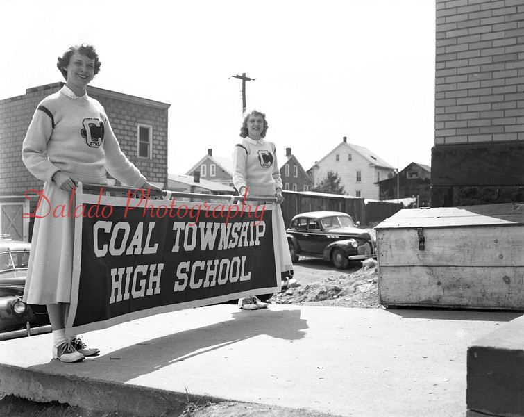 (04.03.52) Holding new Coal Township parade banners are Joan Yoder and Florance Balchunas.