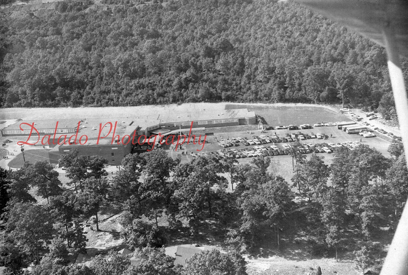 A modern-day aerial shot of Our Lady of Lourdes Regional School- In 1957, 22 acres in the Edgewood section of Coal Township was purchased for $10,000 for the purpose of building a Catholic school. On Jan. 26, 1957, 2,000 area parishioners watched the Most Rev. George Leech, Bishop of the Diocese of Harrisburg, turn the first spade of dirt. Master of ceremonies was Rev. Thomas Leitch, principal of Shamokin Catholic High School, who would later become the first principal at Lourdes. The school was built at a price of around $1 million and dedicated Sept. 13, 1959. Funds for the project came from the 22 parishes it would serve. Enrollment was around 500 students. After the Mount Carmel Catholic High School closed in 1964, a major expansion of the school was undertaken. As expected, enrollment jumped to around 750 students. In 1984, enrollment had decreased to 400 students, 137 of whom graduated in the spring. By 2011, the number of graduates had dwindled to just 35.