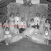 (05.16.1957) Coronation of the Junior/Senior Prom at Trevorton High School. Crowned kind was Joe Ross. Crowned Queen was Joyce Witmer. Attendants included Nancy Revak, left, seated, Darlene Latsha, right, seated. Other members of the court are Kaye Smith, Lais Rhodes, Pauline Minnier, Dennis Erdman, Francis Lagerman, Shirley Hauser and Sandra Vesnefskie. Flower girls are Marilign Breinick, left, and Debbie Miller.