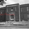 (08.05.54) Workmen rip the interior and entrance from the old Washington School in Kulpmont, which is adjacent to St. Casimir's Church. Plans call for complete renovation to convert it into a convent.