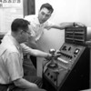 (1956) The new public address system for the Mount Carmel Joint Senior High School was just installed. Holding the microphone is Principal Vincent McHail, who is assisted by Glenn Stewart, of Stewart Sound System of Berwick.