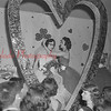 (Feb. 1956) Miss Teddy Grecco, Kulpmont High School student, is crowned Queen of Hearts for 1956 by Connie Grecco, former Queen. Event held in American Legion ballroom.