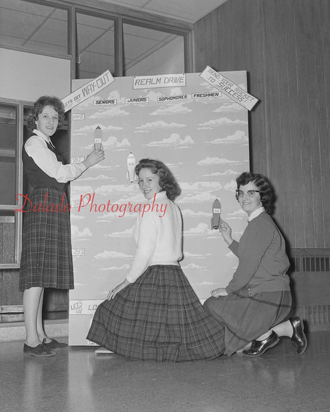 (Jan. 1960) Francis Radziewicz, Rita Flannery and Marie Scandle place cardboard rockets on the chart to show how the yearbook drive at Our Lady of Lourdes is progressing.