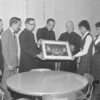(Jan. 1963) Bishop George Leech presents a photo taken at the recent session of the Ecumenical Council in Rome, at which Leech took an active part. Among those accepting the gift are Father Paul Rindos, assistant principal; and Father Thomas Leitch, principal.