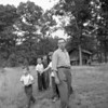 (08.01.57) St. Ed's groups of children with priest Father Lahaut. Cub Scout Pack 3255 meet at the site of the new Central High School.