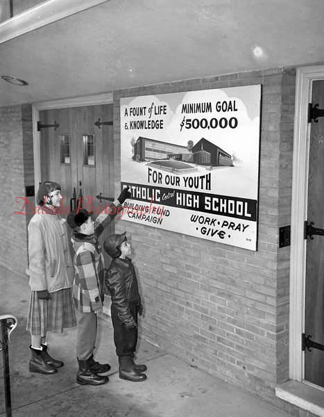 (02.23.56) Looking at the design of the proposed Catholic School are Robert Rosini, Robert Mace and Mary Lou Strausser, of St. Joseph's School.