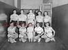 (03.25.54) Trevorton High School gym team. Front row, from left, Deanna Peifer, Mary Ann Rego, Irene Hartman, Betty Hauser and Joan Petraski; second, Deanna DeAngelio, Anita Vottero, Grace Peifer, Nancy Rebuck and Mytle Rhoads.