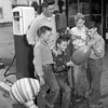 (07.01.54) Youngsters shown using air pumps to fill balloons on South Market Street are Gob Moore, in command of the air pump, Tommy Bamford, John Hanrahan, Joe Kramer and Danny Bamford.