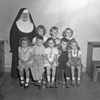 (09.20.51) St. Mary's first-grade under Sister Anastasia are, front row, from left, Christine Darko, Paul Siket, Dorothy Kisela, David Olszewski and Barbara Shervanick; second, Sister Anastasia, MaryAnn Sabotor, James Wheeler and Valerie Komara.