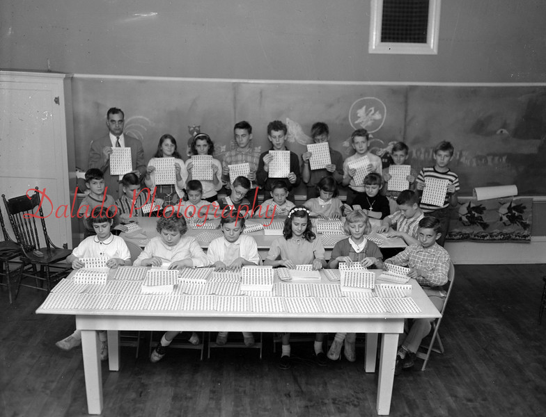 (10.25.56) Grant School students in Mr. Miller's class folding Christmas seals.