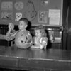 (10.25.56) Gary Metza and Neilie Dietz, students at Lincoln Grade School, decorate for Halloween.