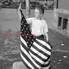 (May 1955) Student at the Lincoln Grade School raising the flag.