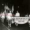 (12.30.1969) The Shamokin Area High School Band is shown in the Sugar Bowl parade. The band also performed the national anthem prior to the game on Jan. 1, 1970. Holding the banner is Deborah Dyer and Karen Compello.