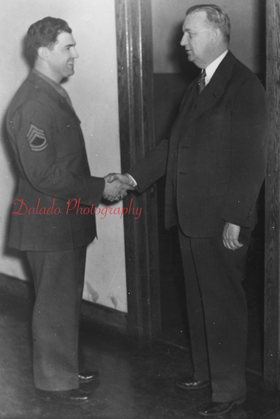 (1958) Dobson and a soldier inside the Shamokin High School.
