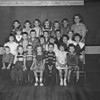 (09.13.51) Stevens School, Shamokin, first-grade class under teacher Gertrude Reitz are, front row, from left, Roger Alleman, Sylvester Kolanda, Philip Nash, Susan Krebs, James Shaw, Veda Meyers and Mary Agnes Adams; second, Evelyn Frye, Gerald Deibler, Sharon Reddinger, Donna Jean Alleman, Linda Carl and Barbara Kautter; third, Sandra Thomas, Robert Curran, Keith Cribbin, Michael Dale and Gertrude Fisher; fourth, Thomas Feese, Richard Hummel, Robert Unger, Ann Rodarmel, James Hopta, Lewis Redick and Mrs. Geraldine Reitz.
