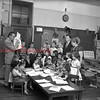 (10.11.1956) First grade students of the Stevens School are given instruction on the Doll Safety Contest. Frank Van Devendee, elementary supervisor, Geraldence Reitz first grade teacher look on.