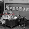 (05.09.1957) Registering children for kindergarten at Washington School, Mrs. H. Richard Hilbush, left, is registering her son Craig, who will begin classes next term. Picture taken May 9, 1957.