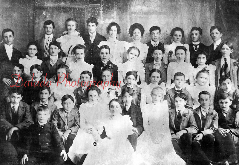(1900) Washington Grade School Class of 1900- Pictured are, front row, from left, UNK, Oscar Kacherles, Bert Kelly, Fred Kershner, Lottie Price, UNK, William Deppen, UNK, UNK, Howard Moore and Samuel Smith; second, Morrel Fitch, William Oram, Elizabeth Lewis, Harry Kramer, Maude Raker, Peter Roth, Gertrude Cooper, Charles Smith, May Humphries and George Morganroth; third, William Boden, teacher; Gertrude Hublar, Walter Reinhart, Elizabeth Marshall, Gilbert Gable, Rella Beard, William Lee, Maude Gilger, Margaret Metz and George Gearhardt; back, Ralph Felix, Maude Hull, Charles Feibig, Gertrude Russell, Flo Malick, Elmer Malick, UNK, William Paul and Mal Leisenring.