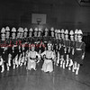 (02.11.54) St. Edward's Church Majorettes. Kneeling are, from left, Patricia Thomas and Dolores Waugh; others are, from left, Maureen Metza, Barbara Karpinski, Marie Zator, Betty Picarelli, Eleanor McBride, Mary Jane Quinn, Jeanette Keating, Virginia Skeepes, Mary Jane Coyle, Natalie Stadnicki, Janeen Elliot, Phyllis Christiana, Margaret Zimmerman, Marie Barnabe, Ann Holland, Judy Bainbridge, Marian Mazzatesta and Mary Arlene Obinski.