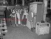 (10.13.1955) Group touring the F&S Brewery on Oct. 13, 1955. Extreme left is J. Oliver Schmidt, executive of the local firm; and on the right is Nesbert Appel, chief brew master.