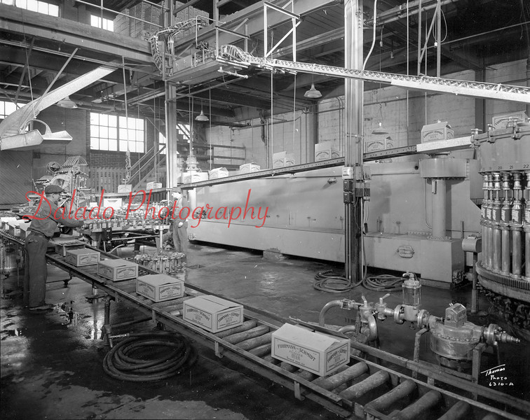 The filling machine- Located on the right side of this photo. The bottle then go to the labeling machine, and finally into the cases.
