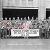 "(06.1939) Members of the Fuhrmann and Schmidt Brewing Company International Brewery Workers Union Local 222 stand in front of the firm's main offices at Commerce and Washington streets in Shamokin in June of 1939. Included in the photo is Ike Zielinskie, front row, fifth from left; Frank Omlor, master brewmaster, ninth from left; and Jerome Zielinskie, twelve from left; back, ""Nibs"" and Bob Appel, second and third from right; and Patrick Kearins III, back row far right."