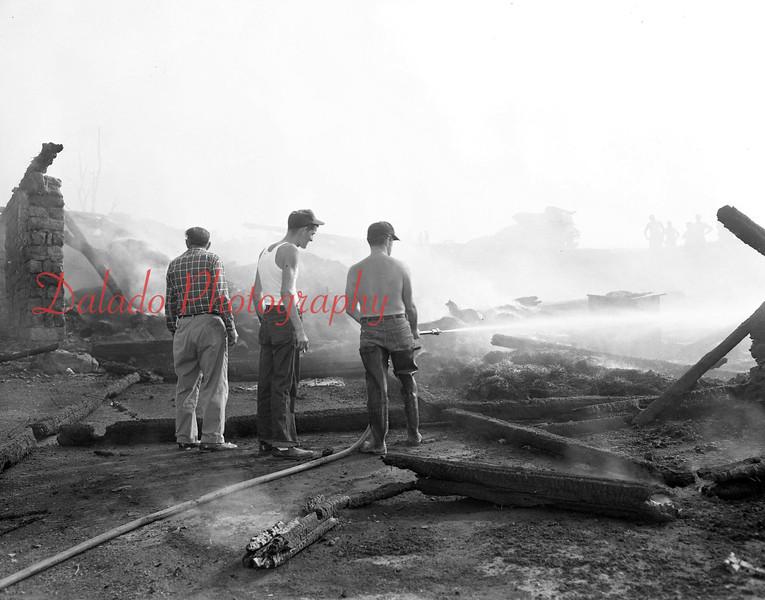 (1962) A barn or house fire.