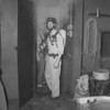 (July 1958) Claude Kehler, director of public safety, comes out of the Crone smokehouse at the Shamokin fire school.