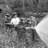 (06.12.58) Proper aim of a fire hose is demonstrated to Scouts Robert Timothy Staniszewski, Ronald Jakubaski and Ronald Owearz by Ed Kropinski.