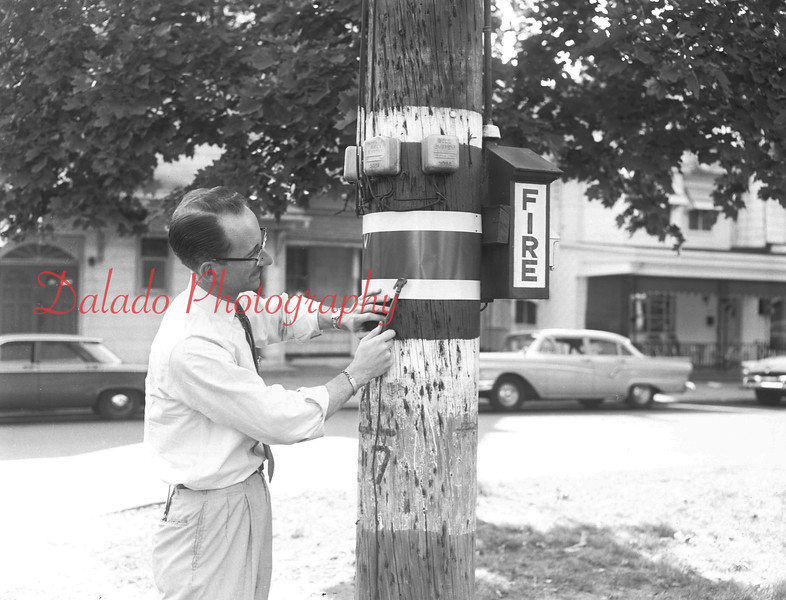 (1962) Claude Kehler checking out a fire box.