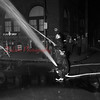 (10.06.52) Firemen manning hoses during a demonstration conduction in connection with Fire Prevention Week. Members of the firemen's training class participated in the demonstration staged on Independence Street.