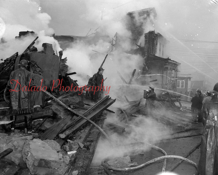 "(12.13.52) Coal Township firemen were handicapped in bringing under control this raging fire that struck the auto body shop and homes of Edwards and Earl Dornbach at around 2:45p.m. Fire officials said neighboring homes were ""red hot"" when they arrived. Rufas Yost, of 1532 Walnut Street, said clothing hanging on a washline was burned."