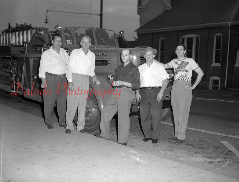 (07.22.1954) Fire officials of the four house companies in Mount Carmel plus the chief. Left to right are Steve Bolick, president of the west end; Ralph Cannon, president of the Clover, Cletus Burns, vice president of the Anthracite, Joseph Petruskiewicz, president of the American Hose, and Florian Conetta, fire chief and member of the Clovers. Taken on July 22, 1954.