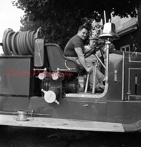 (1956) The Anthracite Fire Co. pumper is back in action after being out of commission after the drive shaft broke. Having to wait to long for a part, Fire Chief Don Williams and Hank & Bill's Garage decided to do the job themselves.