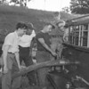 (07.21.55) Learning the fundamentals of attaching a lien to the pumping mechanism of the fire truck are members of the Ralpho Fire Co. Pictured are, from left, Chief Thomas Beskert, Clarence Weikel, Frank O'Brekes, Joe G. and Joseph Malick.