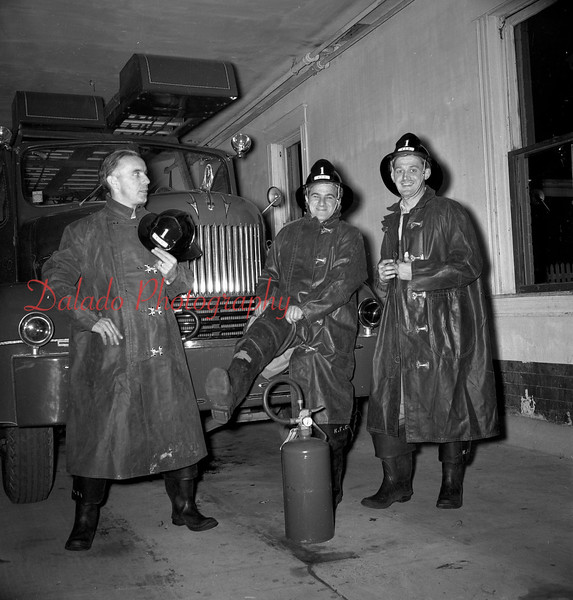 (10.24.57) Members of the East End Fire Co., Kulpmont, are Donald Endrizzi, assistant foreman, left, Bruno Varano and Raymond Balonis, foreman.