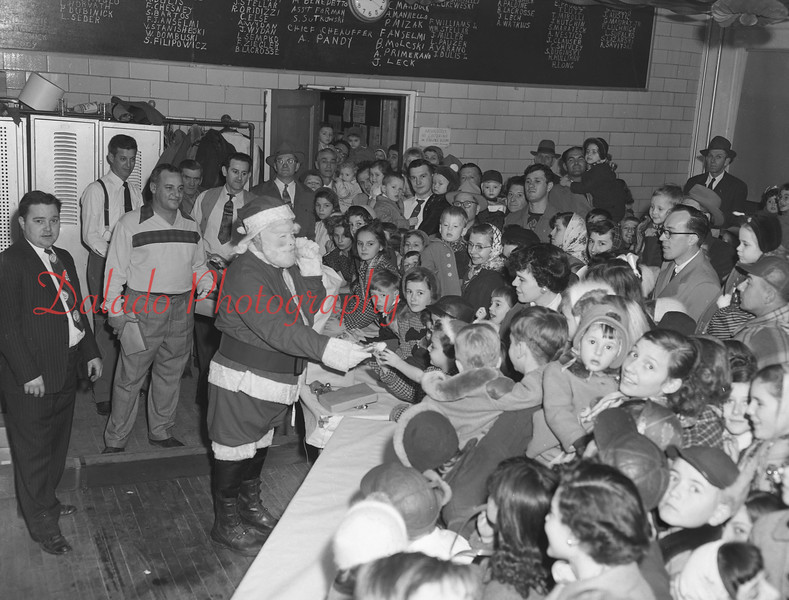 (Dec. 1954) Santa and children at East End Fire Co. in Kulpmont.