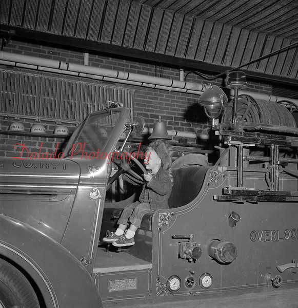 (1956) Boy on the Overlook fire engine.