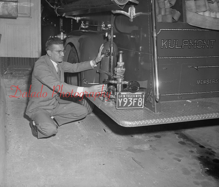 (01.06.55) Edward Politza, new Kulpmont fire chief, examines equipment.