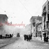 """(12.16.1916) Fair Store Fire- Fire caused more than $500,000 in 1916 dollars on both sides of Independence Street, from Anthracite Street to near Eighth Street, including the Fair Store, one of Shamokin's leading businesses. It is Shamokin's costliest blaze...[This photo is looking east on Independence Street. The """"Fun Shop"""" Building is at left.]"""