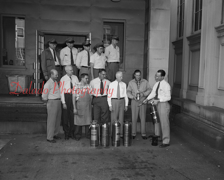(Oct. 19, 1958) Claude Kehler showing members of the U.S. Postal Service how to use fire extinguishers.