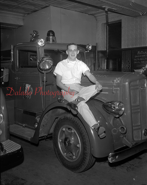 (1963) Buzz Hawk on the Independence Fire Company engine.