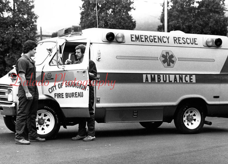 (Sept. 1981) Joe Thew, at right, captain of Shamokin Emergency Squad, uses a radio inside Squad 66 to contact Shamokin Communications Center while Bob Farranato watches. The squad went into service Aug. 3, 1981.