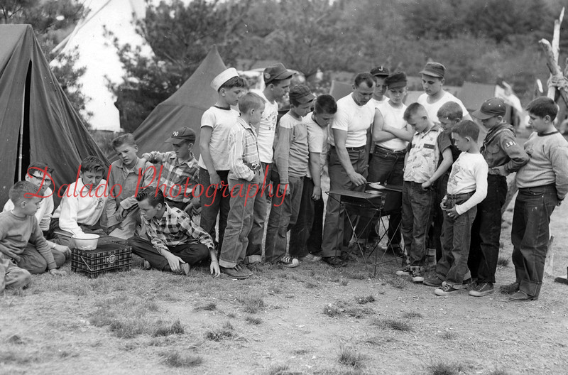 (May 1958) Scouts learn how to use an outdoor stove. This was a demonstration by Scoutmaster Len of Troop 161, Our Mother of Consolation Church.