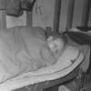 (1957) Boy Scout leader sleeping.